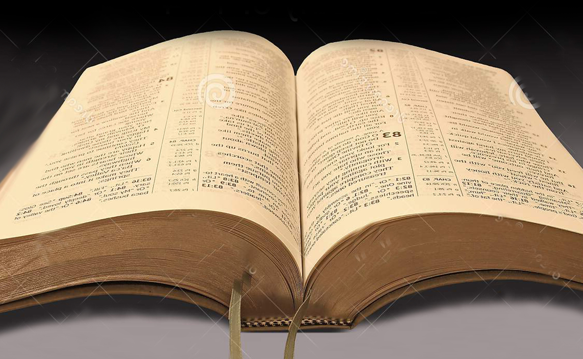Image of book opened to scripture