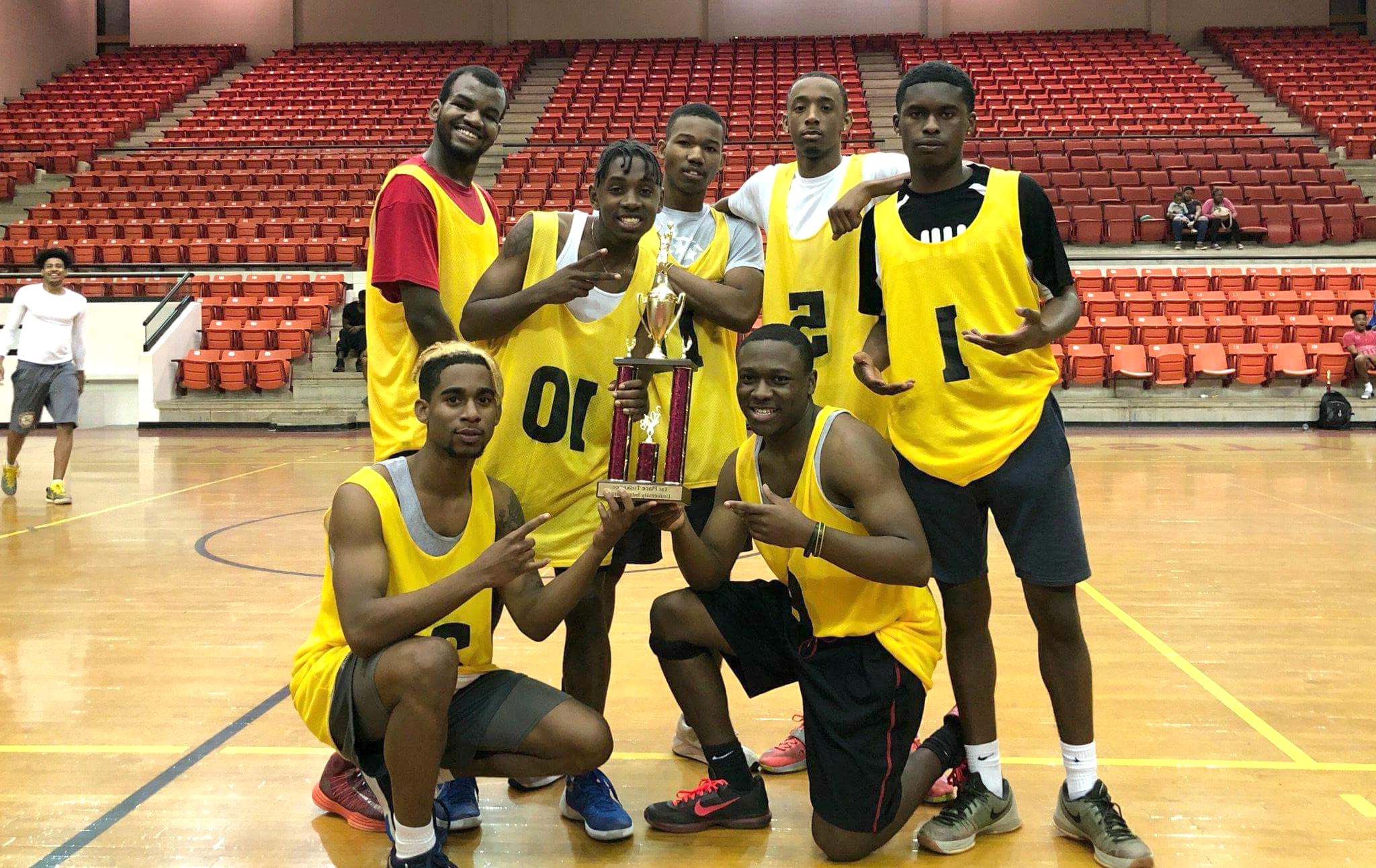Intramural 5 on 5 basketball champs with trophy